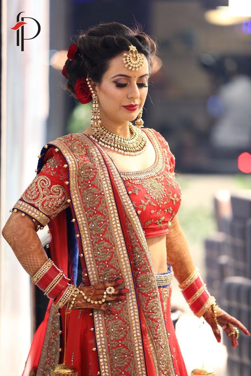 red bridal lehenga with red chooda and maangtikka | bridal lehenga