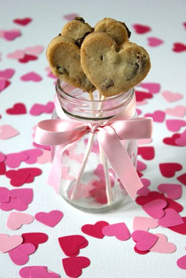 """Here's a Valentine's Day treat that even the most """"undomestic"""" of mamas can make with ease. To make these Valentine's Day cookie pops, all mama needs is a heart-shaped cookie cutter!"""