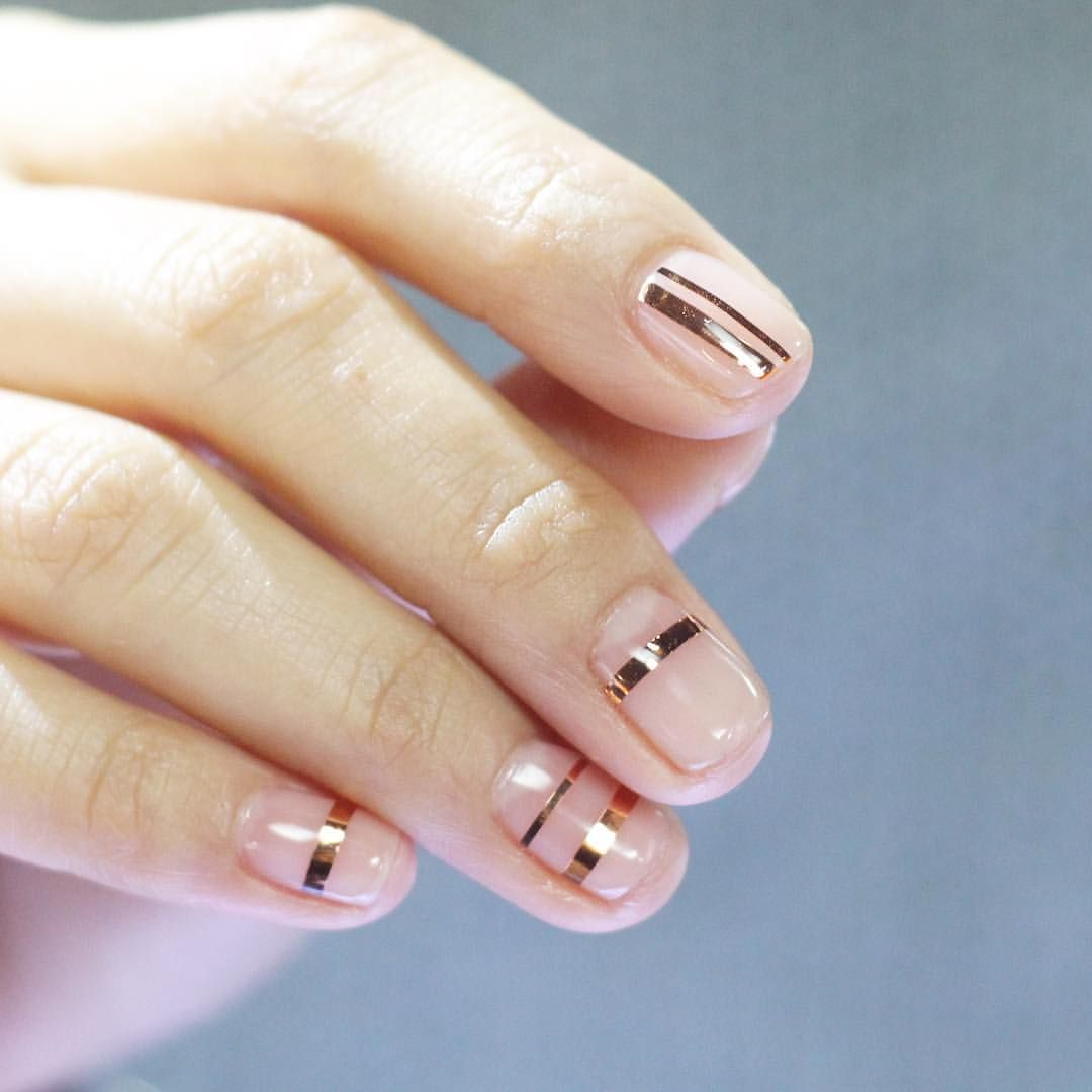 Coat And Thin Gold Strips For A Minimal Subtle Manicure Made Easy