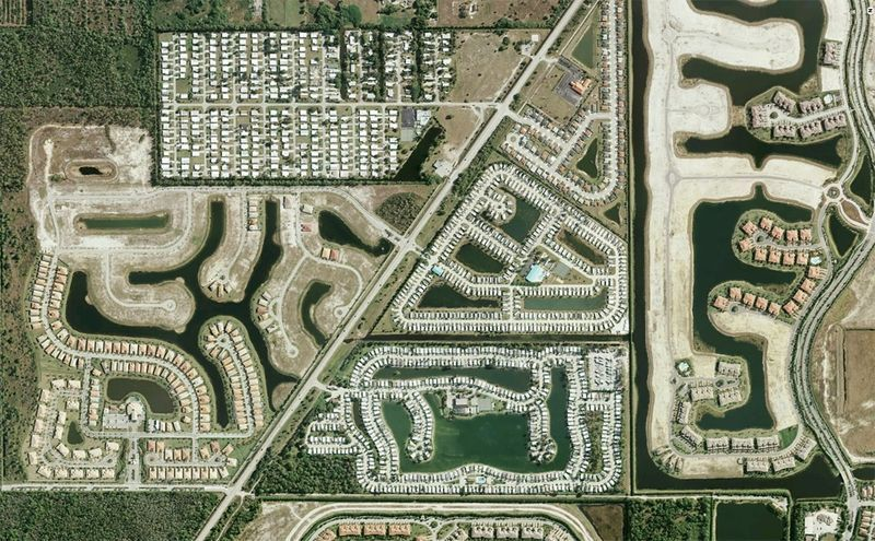 human landscapes in south west florida from google earth (via the big picture) illustrate the boom and (2008) bust of the housing market, as huge developments sit partially completed among densely built up neighborhoods and swampland (5th and 6th photos). many of these homes have been empty for years