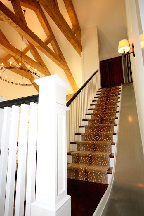 Fun Staircase With Built In Slide Alongside A Stark Antelope Runner Framed  By White Spindles