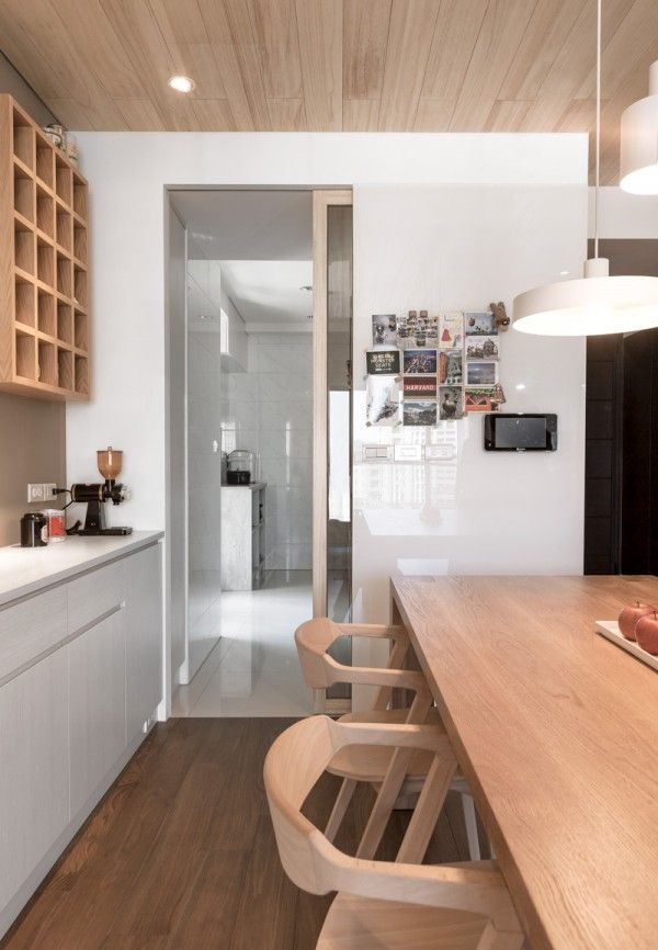 A modern apartment celebrates the look of natural wood white kitchen