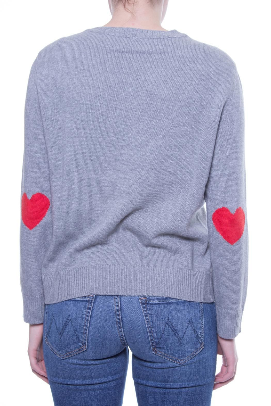 RED VALENTINO Heart Elbow Sweater   A simple and sweet RED Valentino sweater with red hearts over the elbows. Pair with a pencil skirt for work, or a pair of skinny jeans for a casual day outfit.  [Available from Perch on Shoptiques]