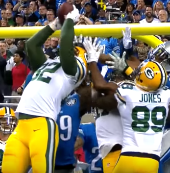 Aaron Rodgers throws a miracle pass to Richard Rodgers for