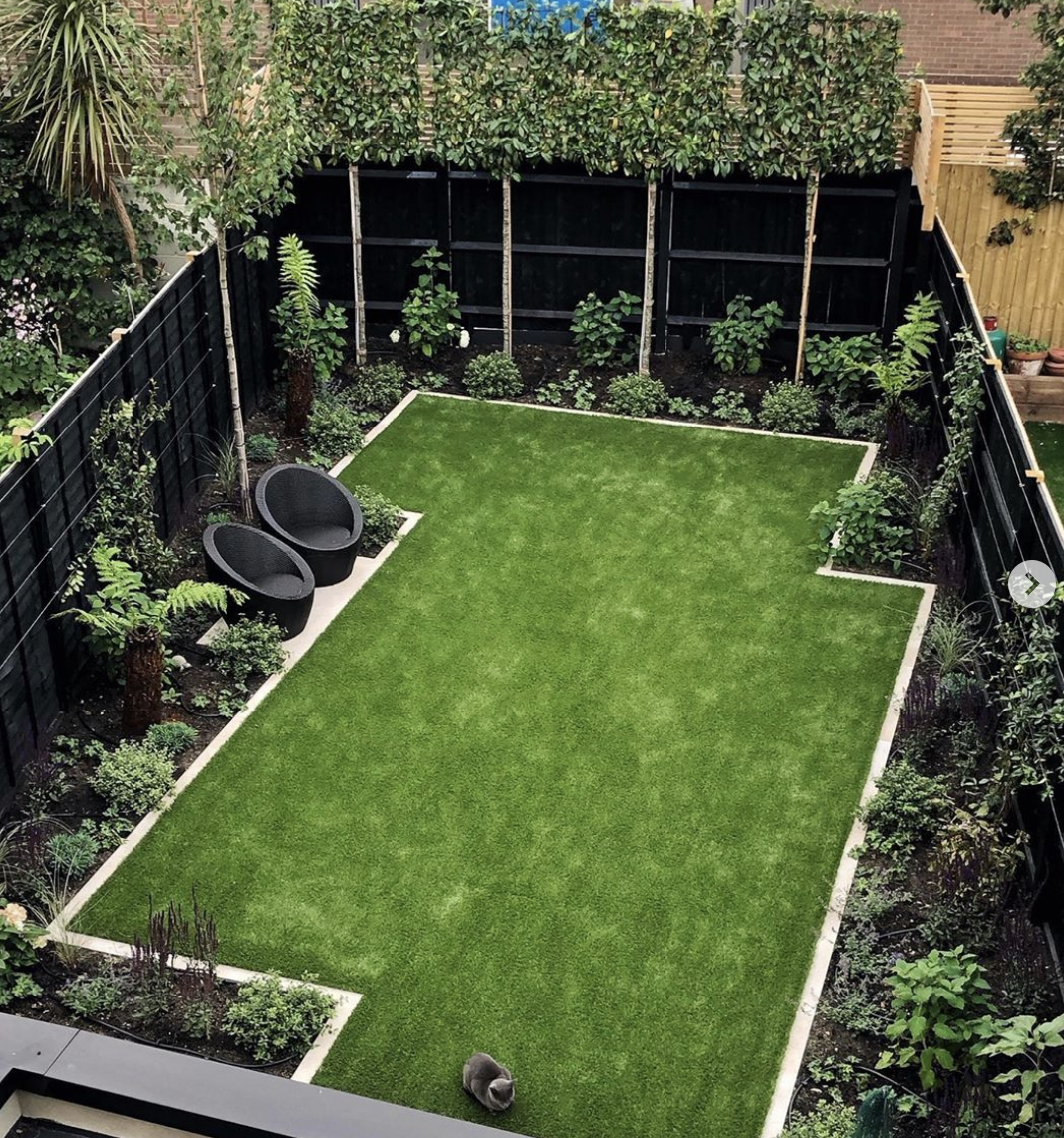A Modern Family Garden With Pleached Trees And Artificial