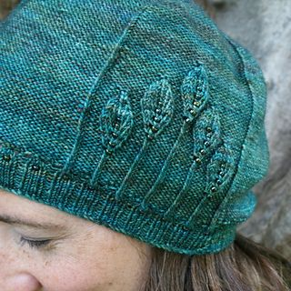 This irresistible hat is embossed with elegant leaves. To make it extra special, details are picked out with pretty beads.