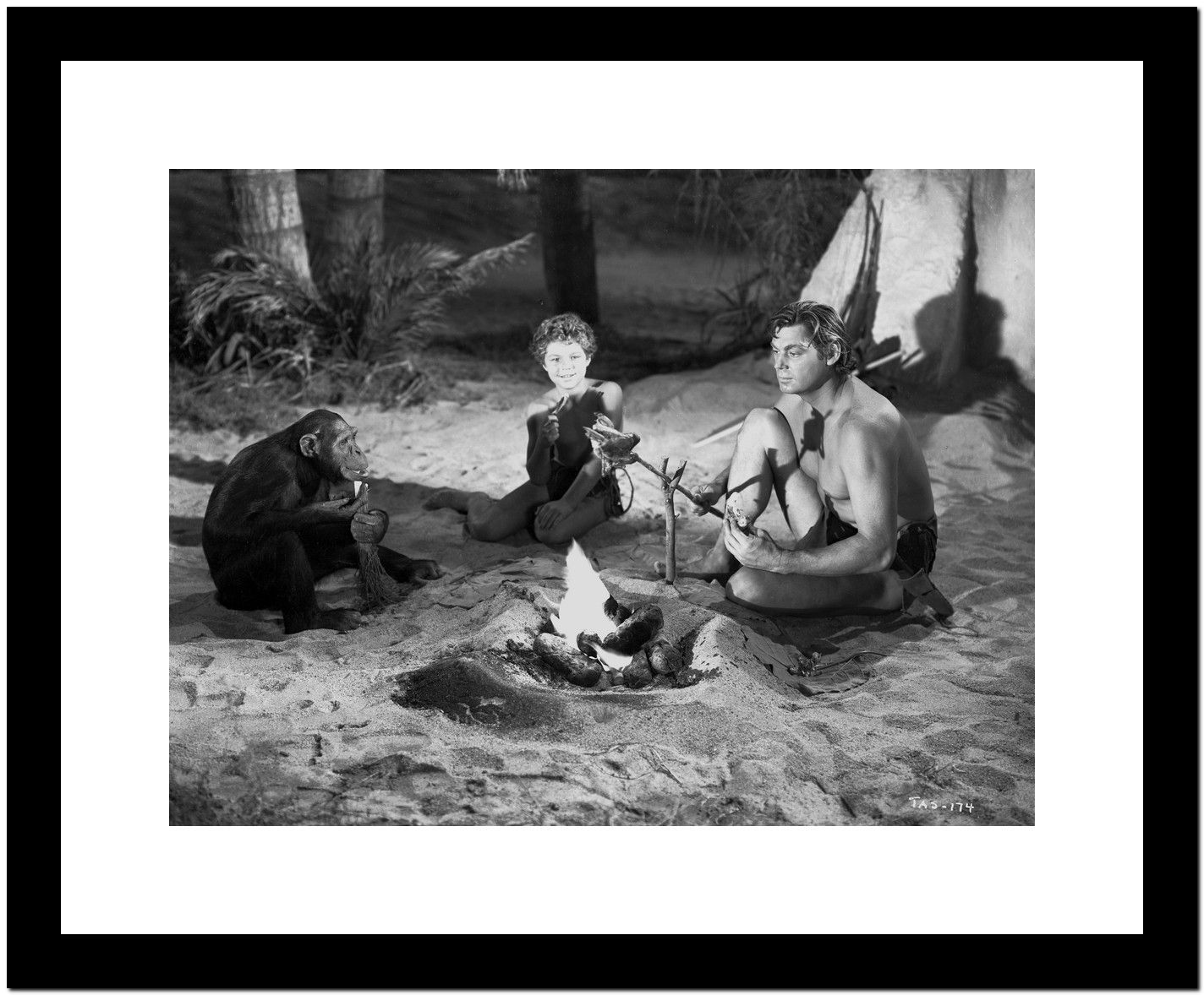 Johnny Weissmuller Grilling Their Food in a Classic Movie Scene Premium Art Print
