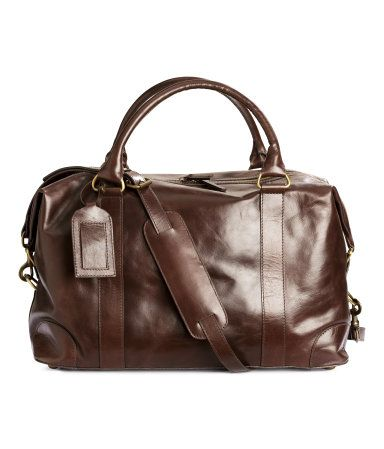 Leather weekend bag in leather with two handles and a zip at top. Detachable adjustable shoulder strap, one large compartment and inner compartment with zip, studs at base, and reinforced edges.   H&M For Men