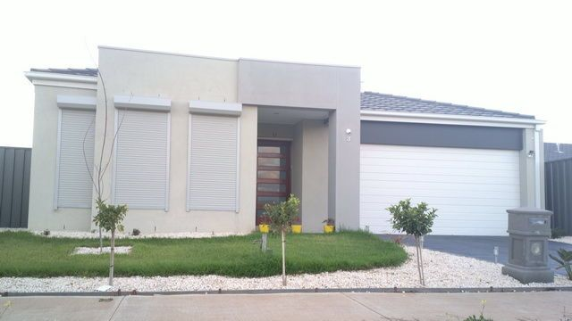 Exterior Luxury Modern House Exterior Design With Minimalist Garden And  Metallic Roller Shutters Modern House With