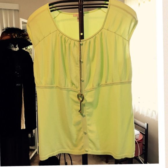 THE ACCENT TOP YOU NEED IN BOLD LIME  COLOR Simple with dainty details and satiny covered buttons. 26 inches long. Stretchy rayon and nylon. Never worn but no tags. Dressbarn Woman Tops