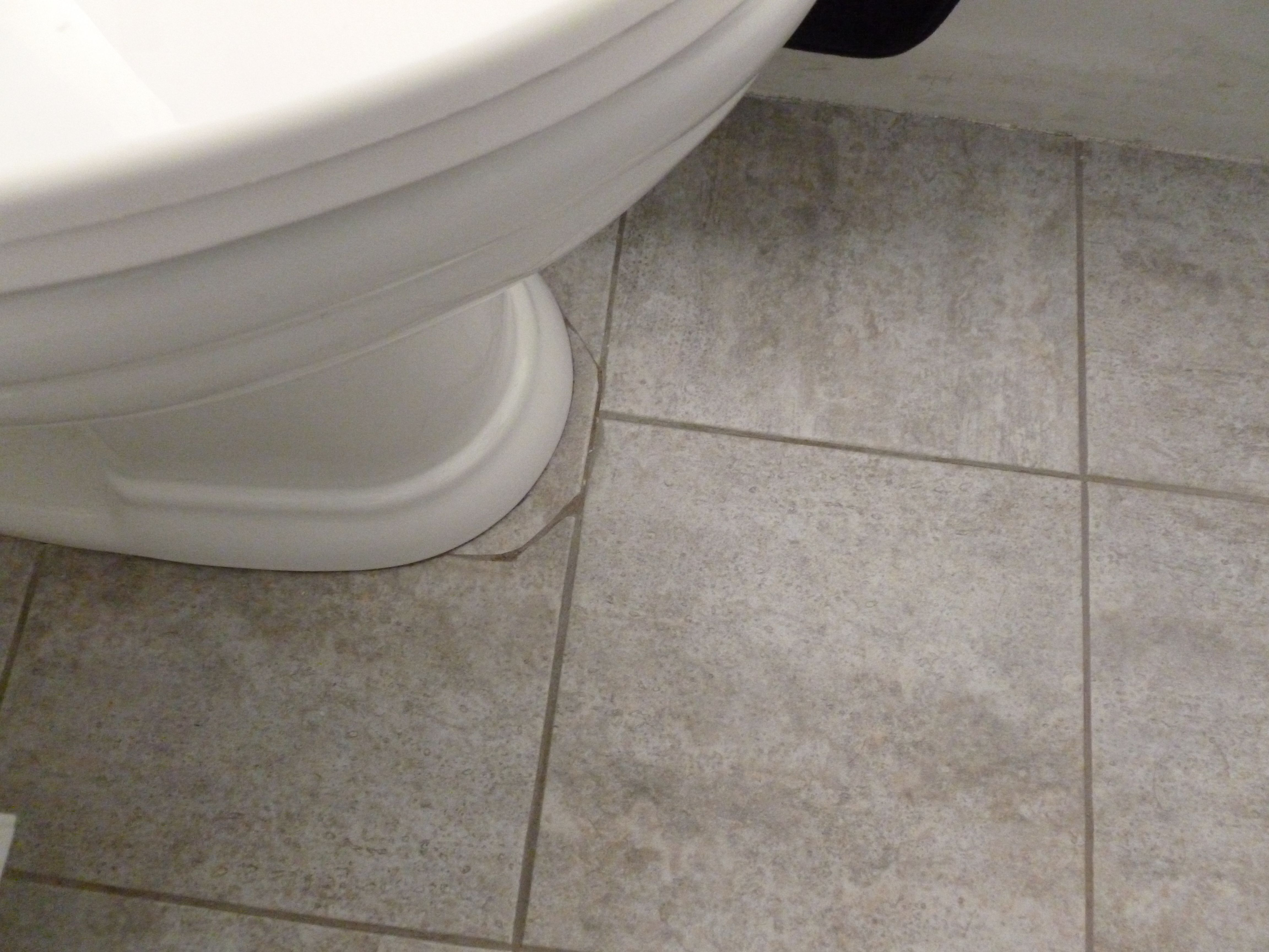 Here is how i remedied the problem of my trafficmaster ceramica here is how i remedied the problem of my trafficmaster ceramica peel and stick grout able tile being cut around the old toilet and leaving a gap after we dailygadgetfo Image collections