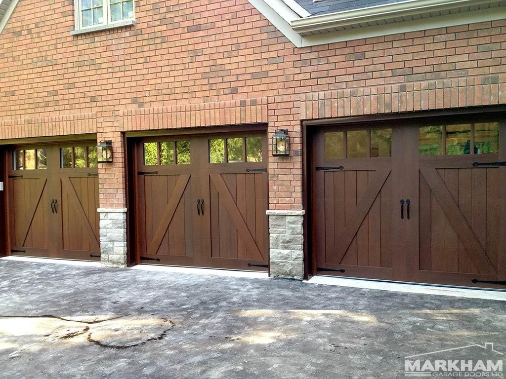 An Insulated Steel Walnut Tone Carriage House Door Can Be Ideal For Low Maintenance Durabil Garage Door Design Garage Door Installation Carriage House Doors