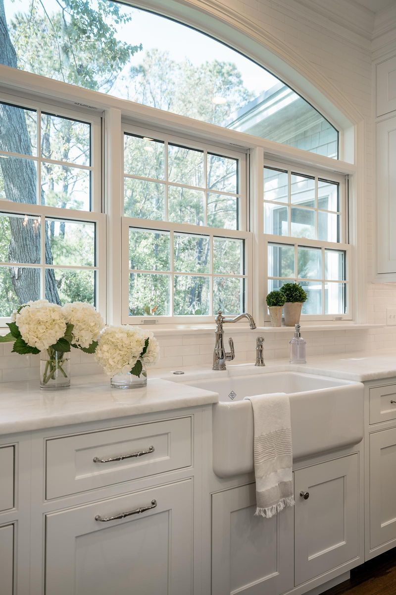 Adding Windows Above The Sink Can Add Depth To The Kitchen It Allows Natural Light And Helps T Large Kitchen Sinks Kitchen Window Design Cottage Style Kitchen