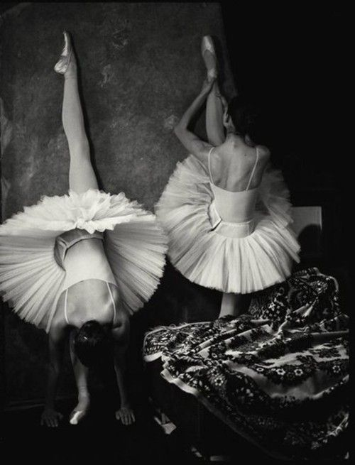 Point Your Toes. Ballet dancers stretch backstage. Tutus galore.