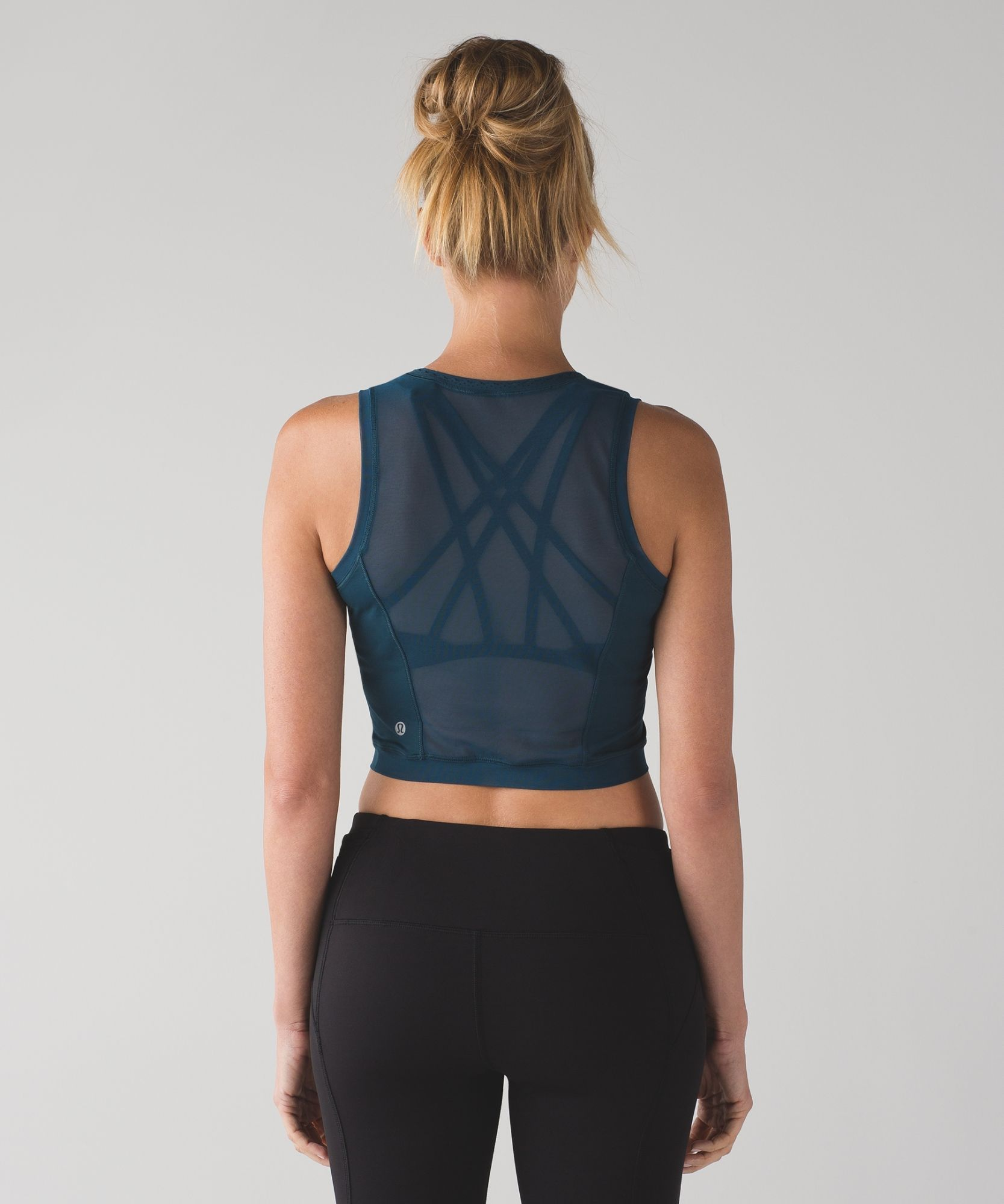 bd7476efe38f58 Keep cool when you re on the run in this high-neck crop top designed with  Mesh fabric for ventilation.