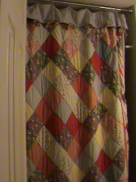 An Old Quilt That I Used For A Shower Curtain