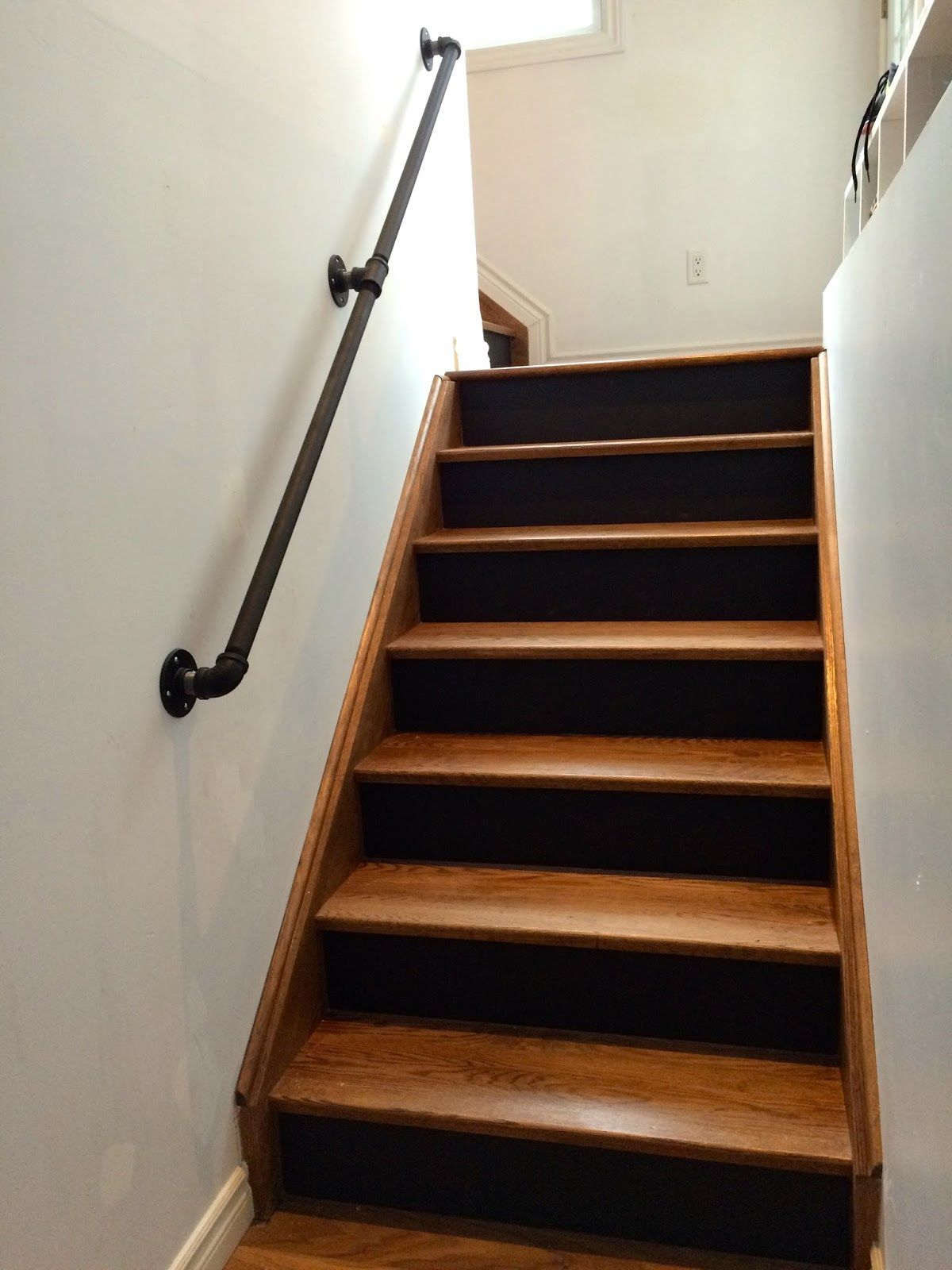 gas pipe railing, walnut stairs, black risers