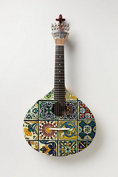 maybe make myself on old guitar? Tiled Fado Guitar   #anthropologie