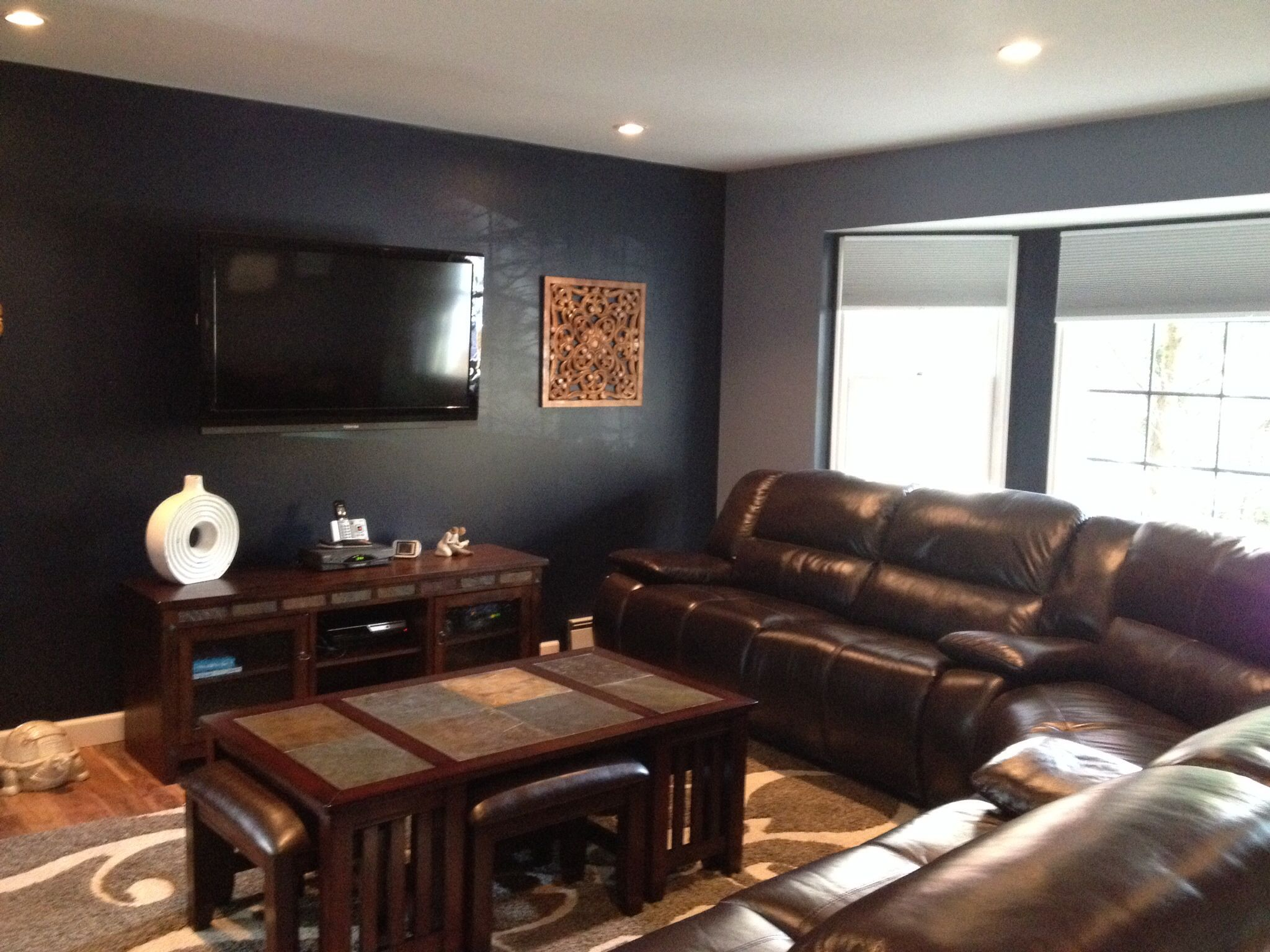 After Navy blue and brown living room entertainment room