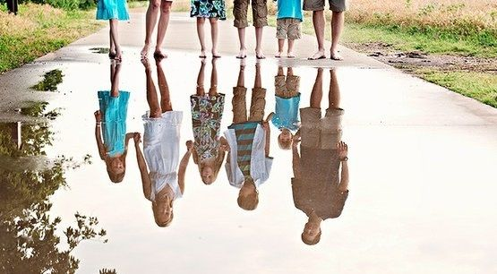 Since we are experiencing April showers, get the family together for a unique family portrait using a reflection of standing water.