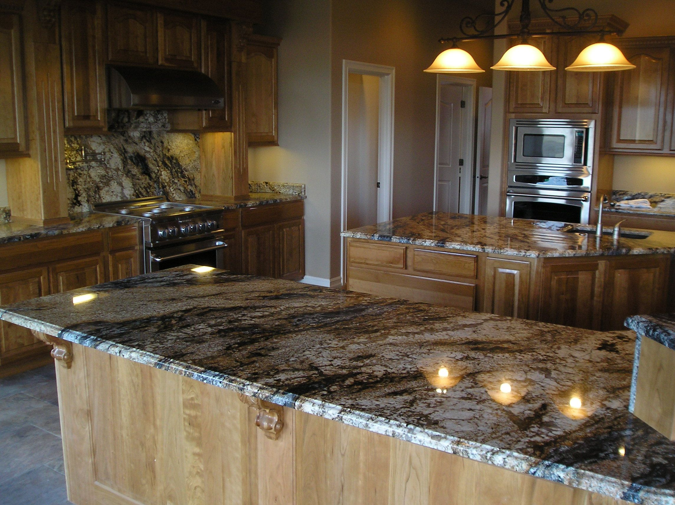 light maple cabinets with a granite that has a little blue in it - pretty | Blue countertops ...