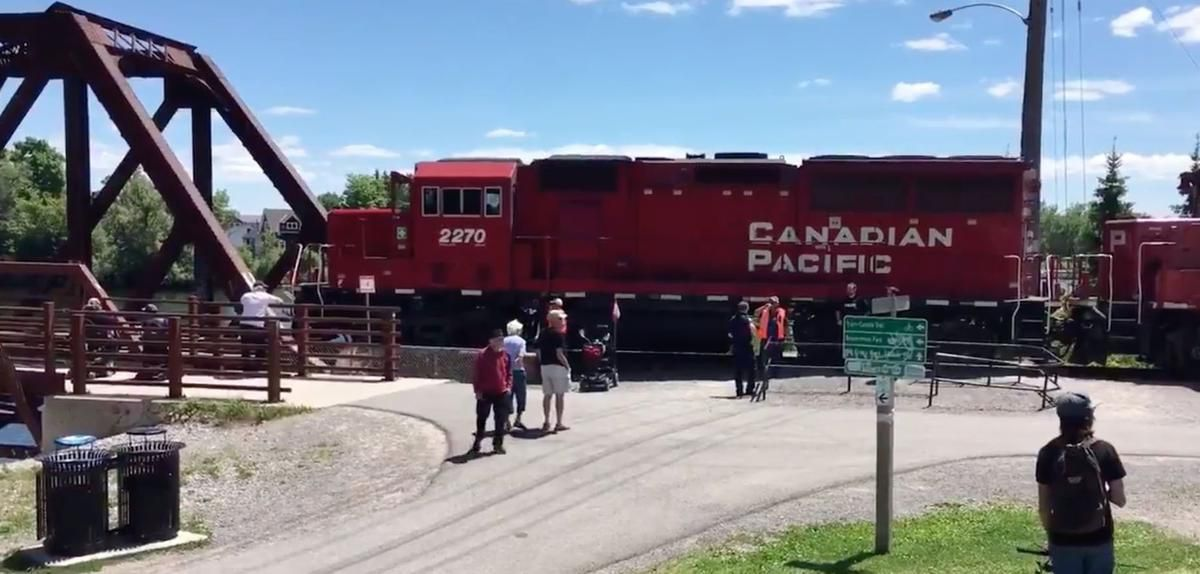 Downtown peterborough streets blocked by train after man