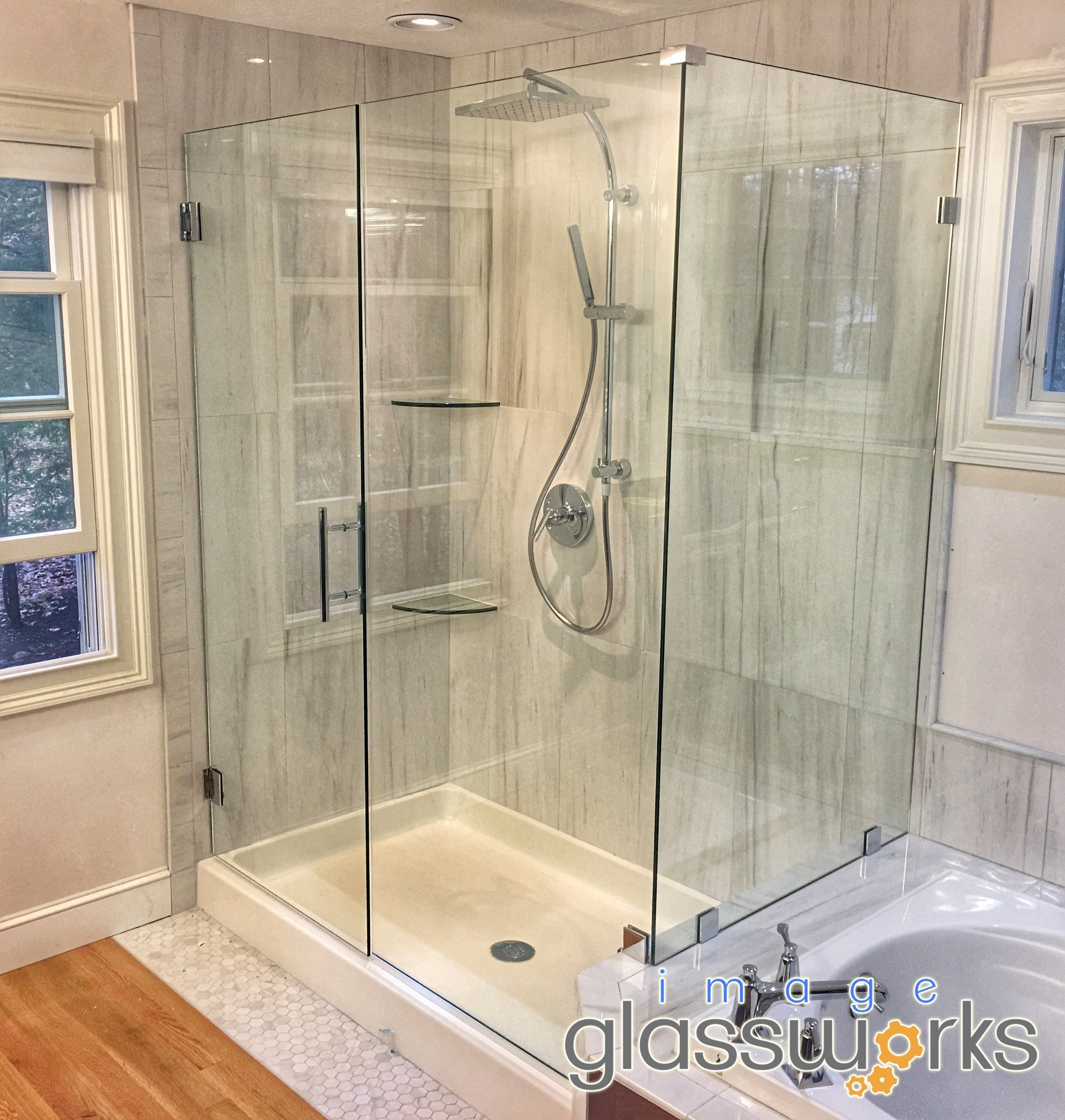 Frameless Steam Shower Enclosure With An Operable Transom Steam