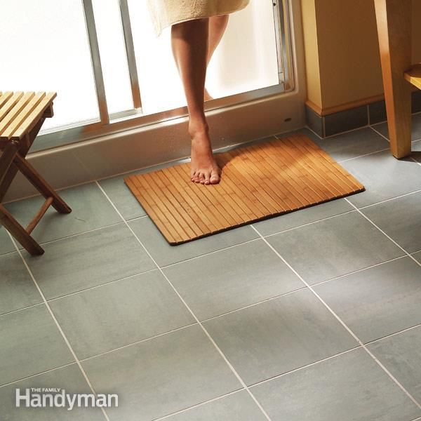 Install a ceramic tile floor in the bathroom ceramic tile floors give your old worn out vinyl floor a new look with elegant tile we solutioingenieria Image collections