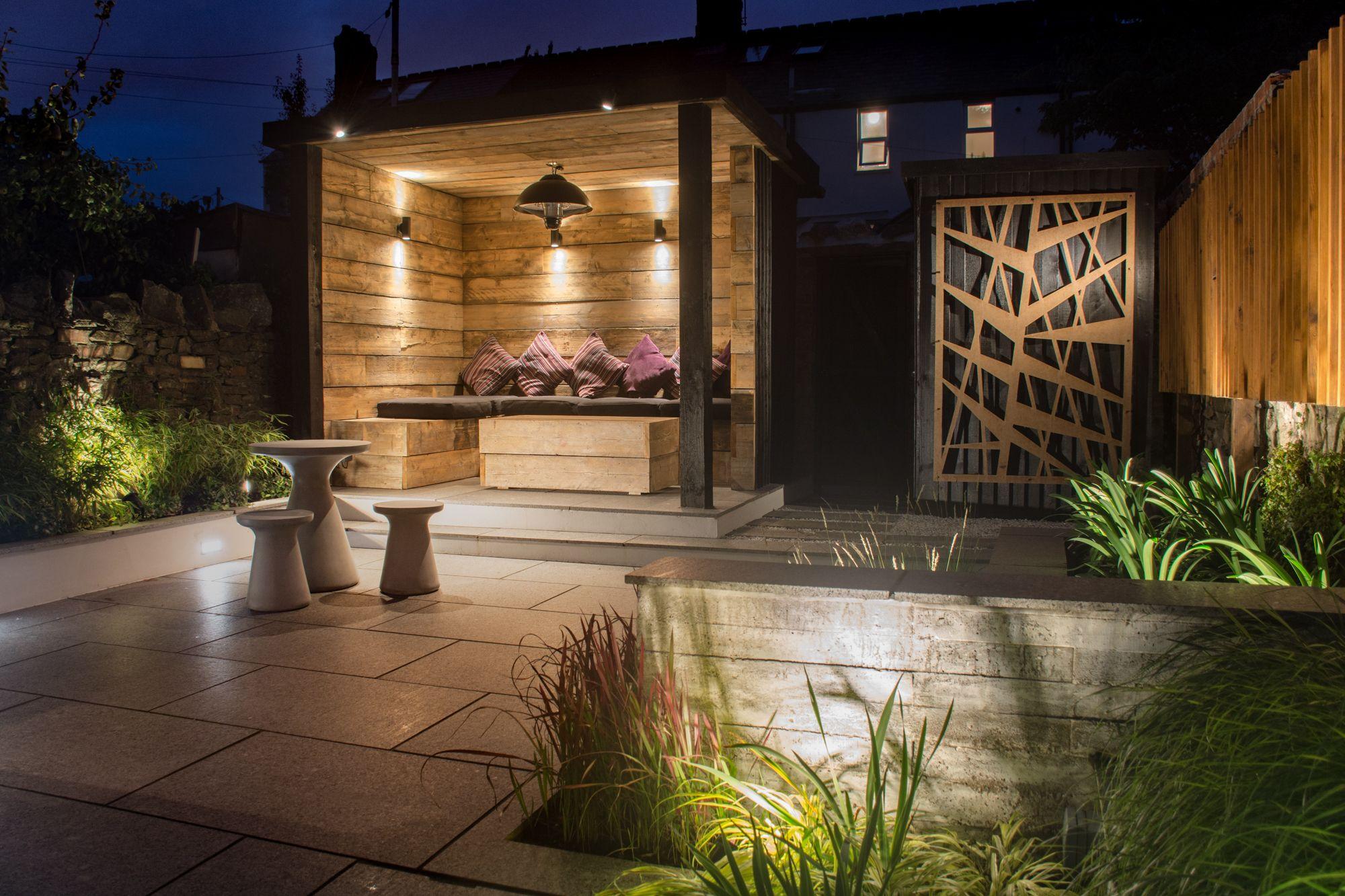 garden lighting in a contemporary industrial garden by robert hughes garden design cheshire