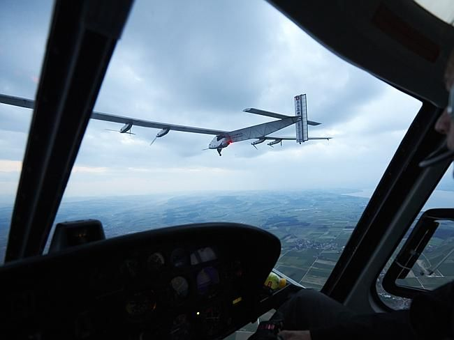 News.com.au: First flight ... The solar-powered Solar Impulse 2 aircraft is observed from a helicopter during its first test flight iJune 2014 in Switzerland.