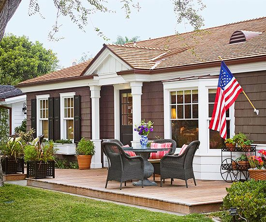 Nice deck area ~ would like one similar but a bit larger with a wheelchair ramp for accessibility purposes ~ siding and trim colors are nice but would probably not go with black shutters/door