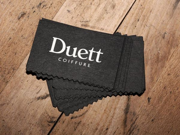 New logo and business card with white ink and die cut detail for Swiss hair salon Coiffure Duett designed by Bureau Collective