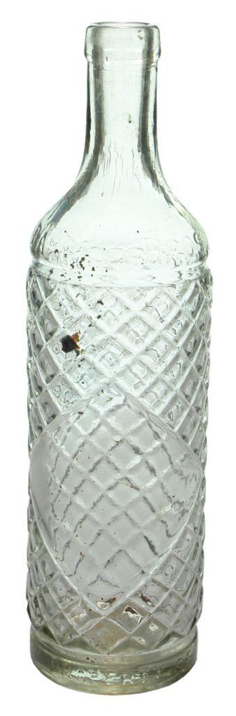 Later Barrett Bros North Fitzroy Cordial bottle. Clear Glass. Lattice pattern. c1940s