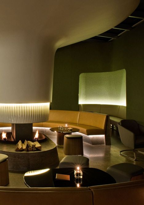 Nature-inspired hotel by Jouin Manku features an organic fireplace