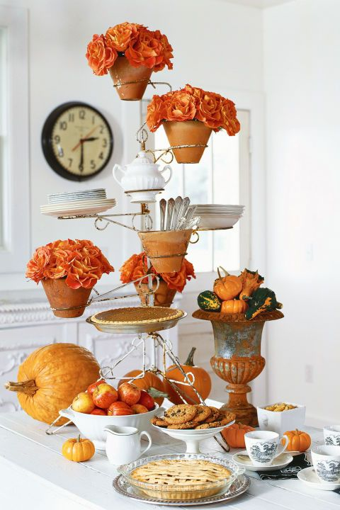 Add a playful yet practical touch to your table by bringing an outdoor piece — like a garden plant stand — indoors and placing a cake, tart, or pie into the stand's arms.