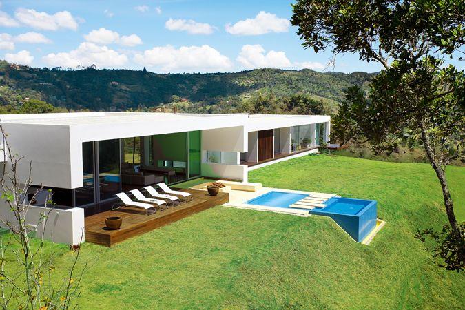 Fachada la casa de tus sue os casas prefabricadas for Diseno piscinas modernas colombia