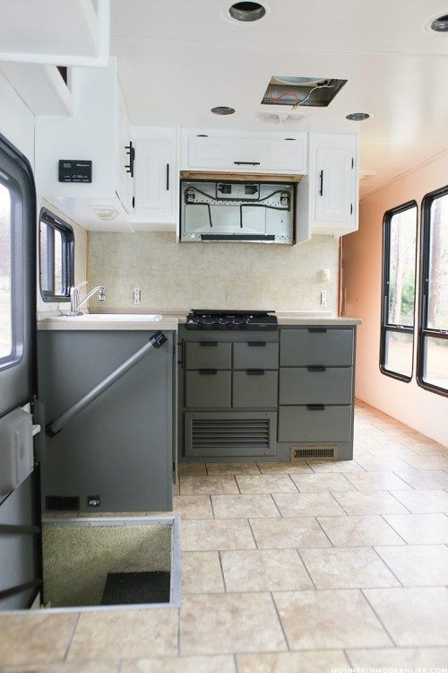 Planning to update the kitchen in your camper or motorhome? Come check out the progress of our painted RV kitchen cabinets! MountainModernLife.com