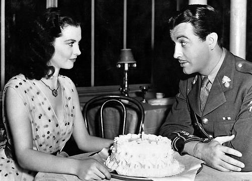 "On the set of ""Waterloo Bridge"", Vivien Leigh celebrates her birthday with co-star Robert Taylor, November 1939."