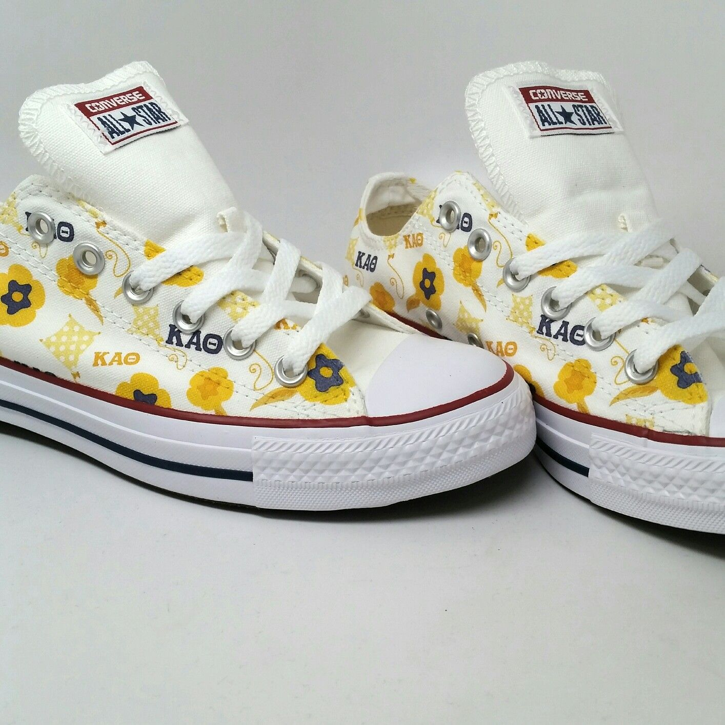 3f0889a04e57 ... spain theta custom converse chuck taylor all star low tops with kites  and pansies 229a0 7fd9c