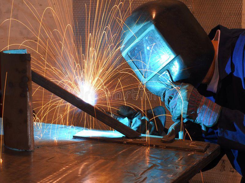Welder. Factory welder doing his hard job , spon,