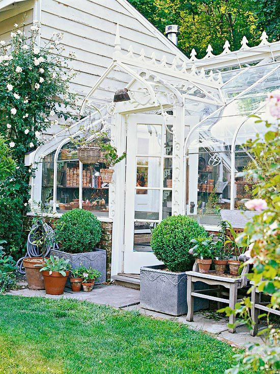 Vintage Greenhouse.  Both useful and beautiful, a greenhouse provides a place to keep tender plants as well as space inside to relax and enjoy a cup of tea amid natural surroundings. Here, a restored vintage greenhouse features an ornate scrollwork door frame and a decorative peaked roof surrounded by all-glass walls.