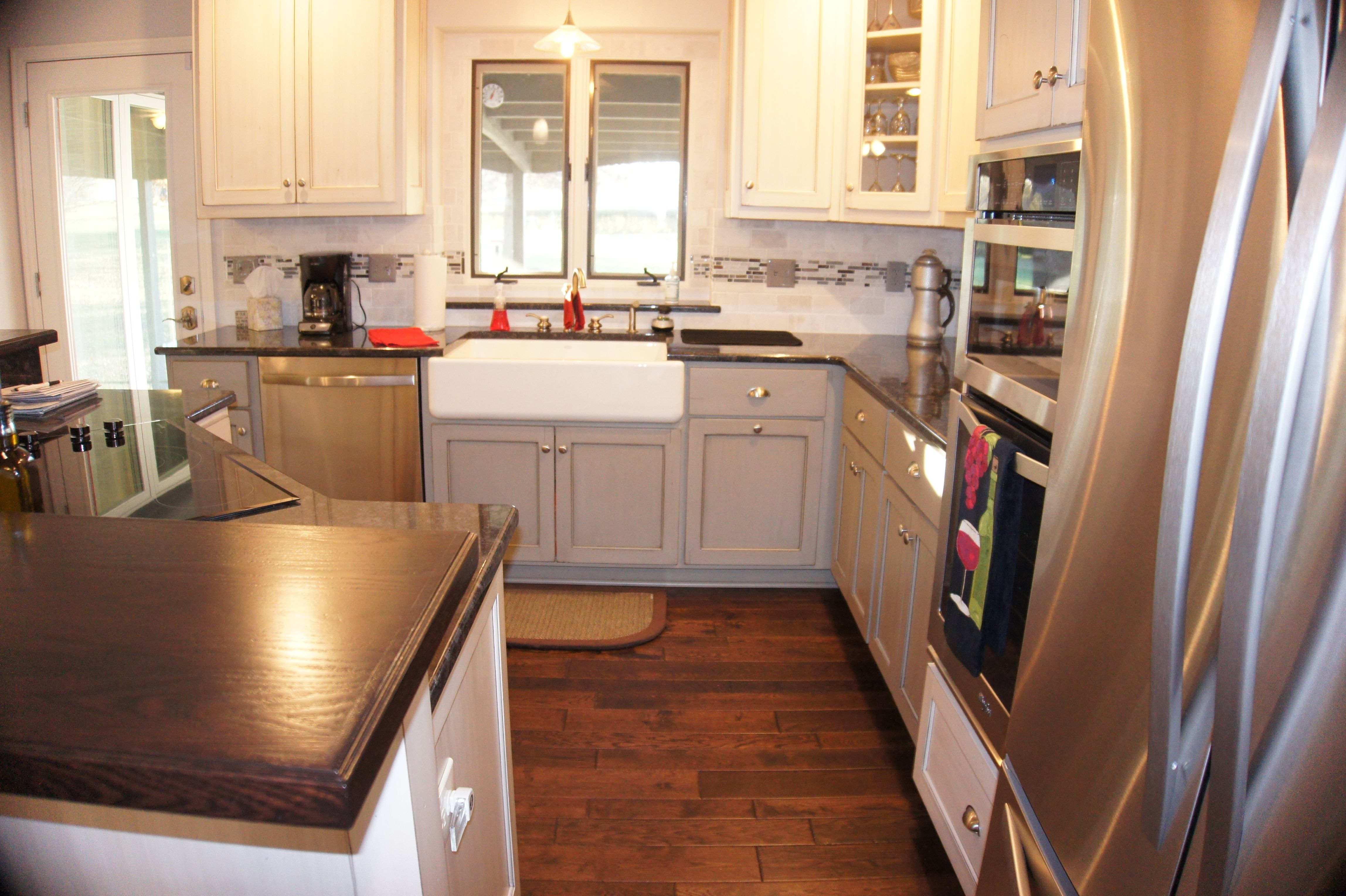 Complete kitchen remodel. Cabinets are gray on the bottom ...