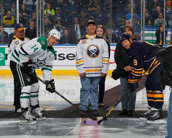 4faaf7d03 Pediatric cancer survivor Jason drops the puck for a ceremonial face off on Hockey  Fights Cancer night between  Sabres Steve Ott and  Stars Jamie Benn  Oct ...