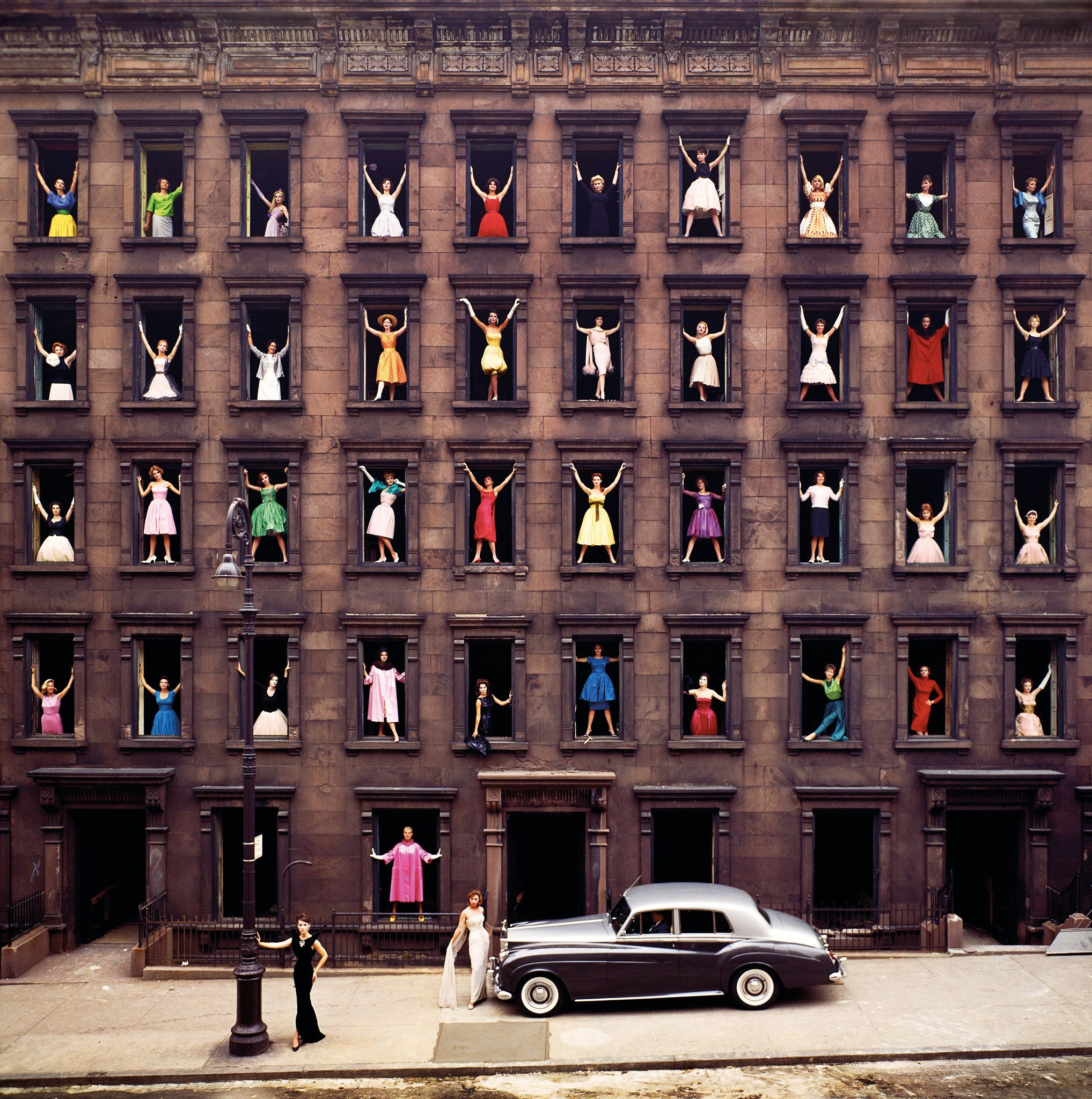 """Girls in the Windows, 1960.  From 'Girls in the Windows: And Other Stories by Ormond Gigli': """"...He was living on East 58th Street, in a brownstone that he bought with his earnings as a freelance photographer — take a deep breath, the dizziness will pass — and developers were razing the brownstones across the street to make room for a modern building. Mr. Gigli saw a grid of windows — 40 stages on which to mount a drama of creation and destruction in the big city...."""""""