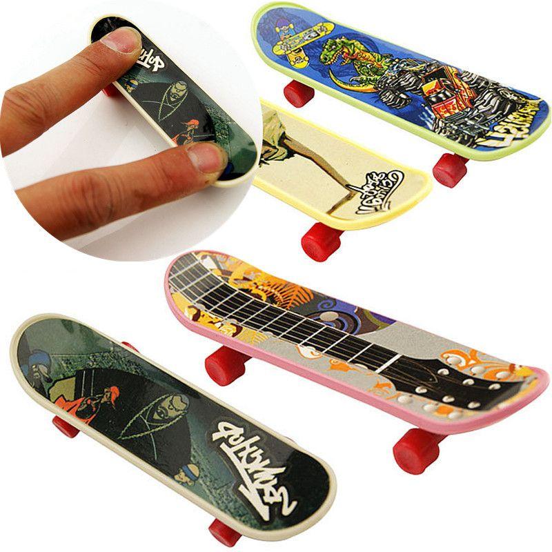 2016 New Hot 10PCS/LOT High Quality Cute Kids Children Mini Finger Board Fingerboard Skate Boarding Game Toys Gift