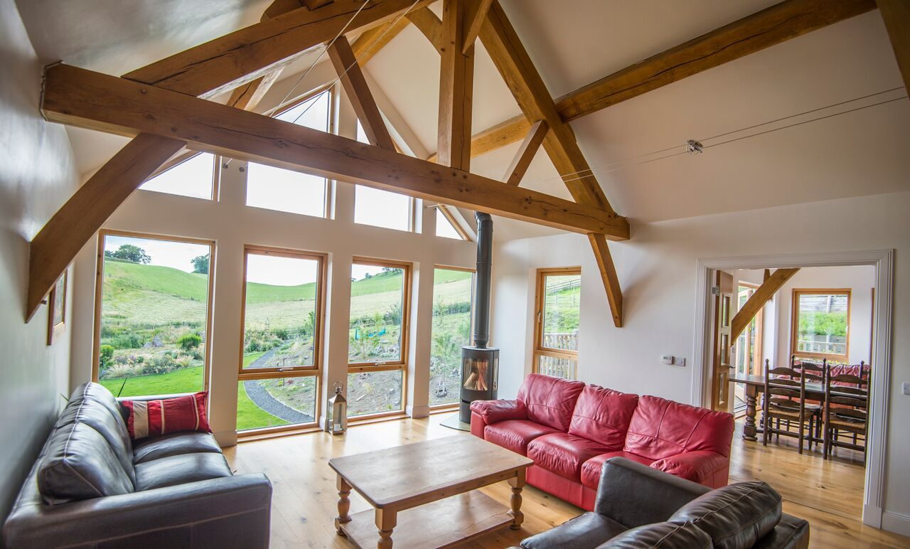 Exposed beams oak truss glazed gable self build