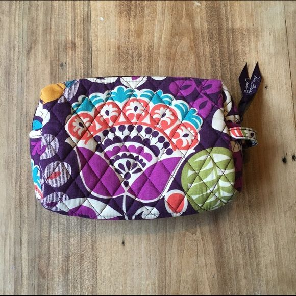 Vera Bradley makeup bag Small holes from tweezers I think) and a couple stains on the inside. Outside is in perfect condition though! Vera Bradley Bags Cosmetic Bags & Cases