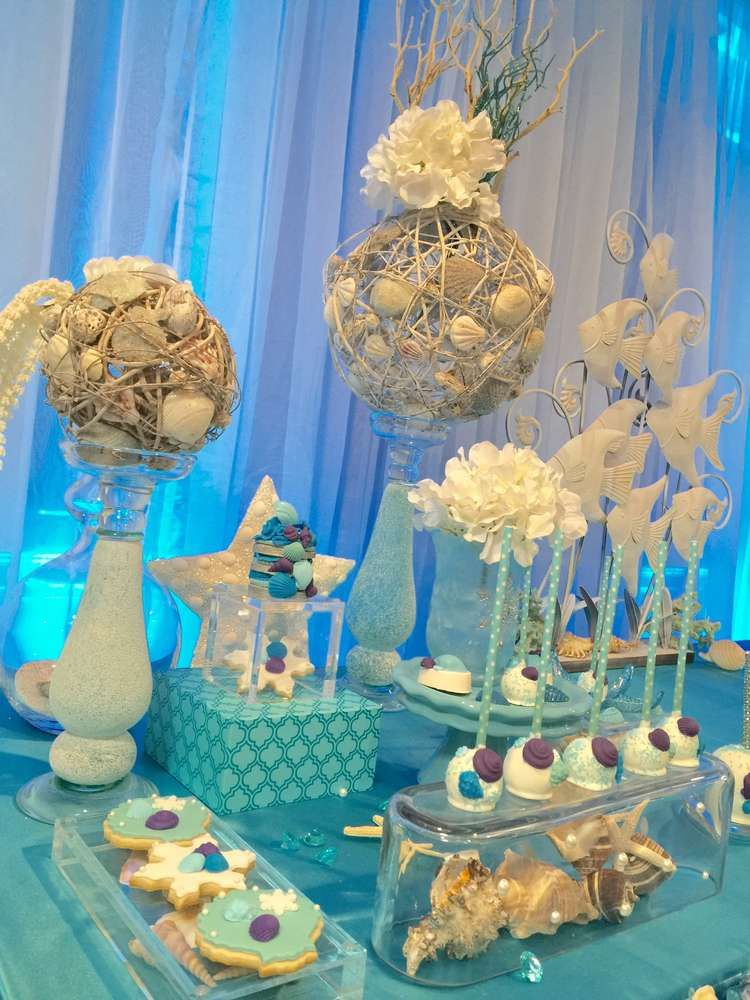 Cookies and cake pops at an under the sea Quinceañera party