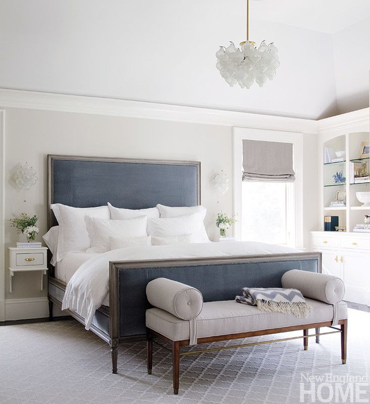 A custom designed light fixture adds drama to the high ceilinged master bedroom - Blue and Grey Bedroom