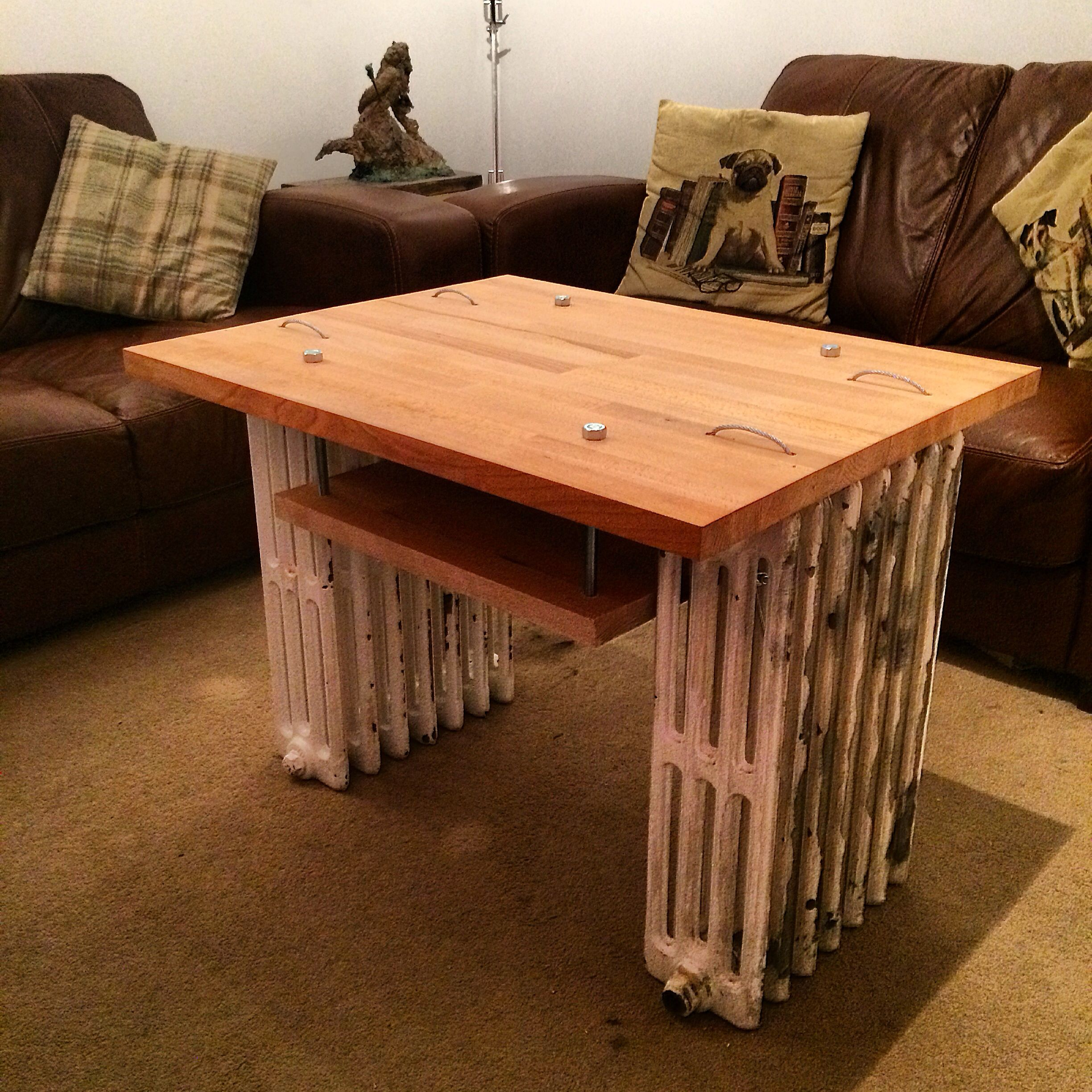 Upcycled coffee table. Old cast iron radiators, wire rope